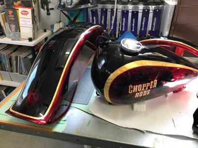 Harley project incorporating 23k Gold leaf and graphics buried under House of Kolor Brandywine Kandy.
